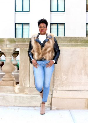 leather moto jacket and faux fur vest outfit