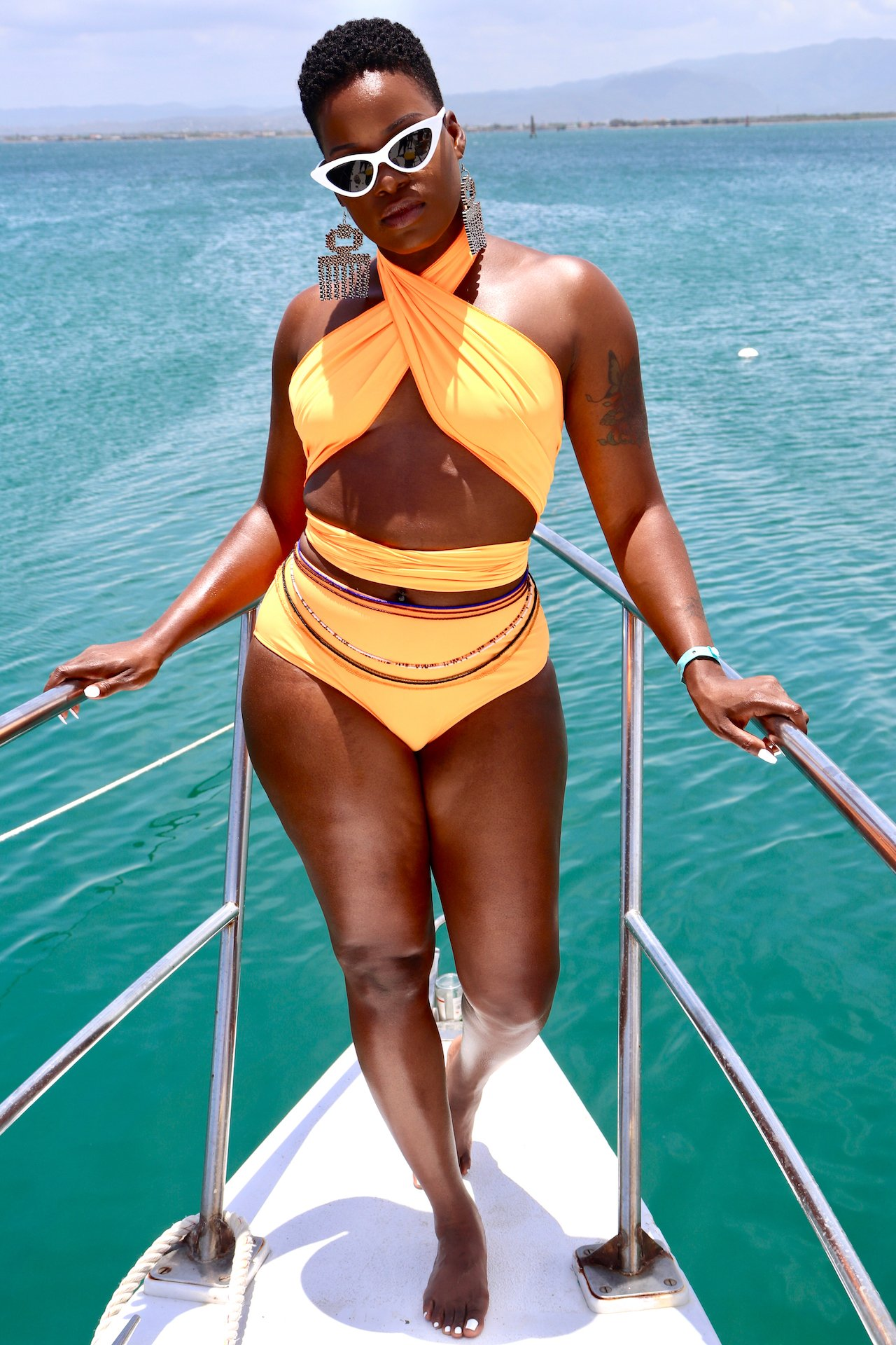 Dark Skin Orange Swimsuit Vacation In Jamaica
