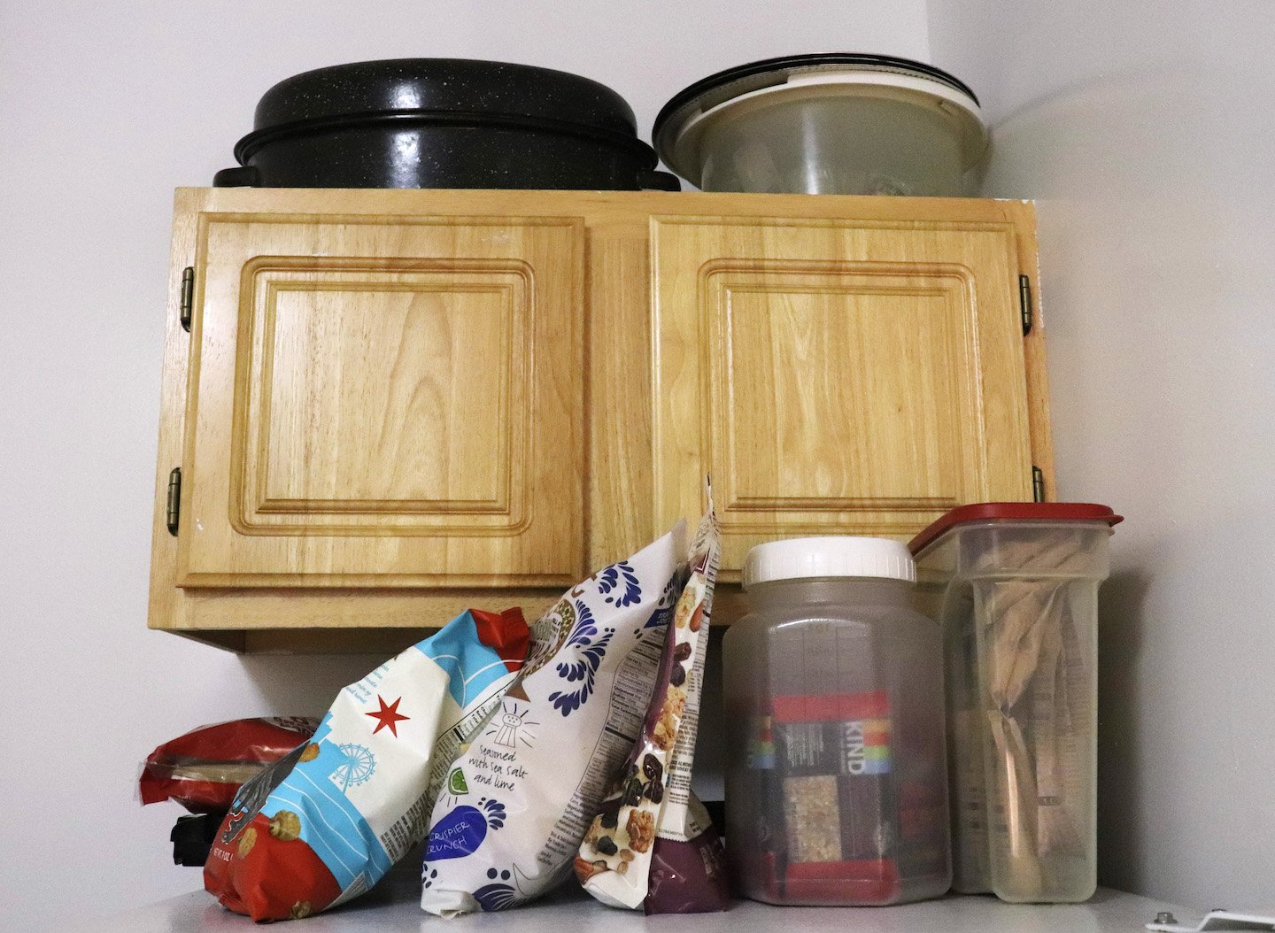 Use the top of the refrigerator for extra storage space in kitchen