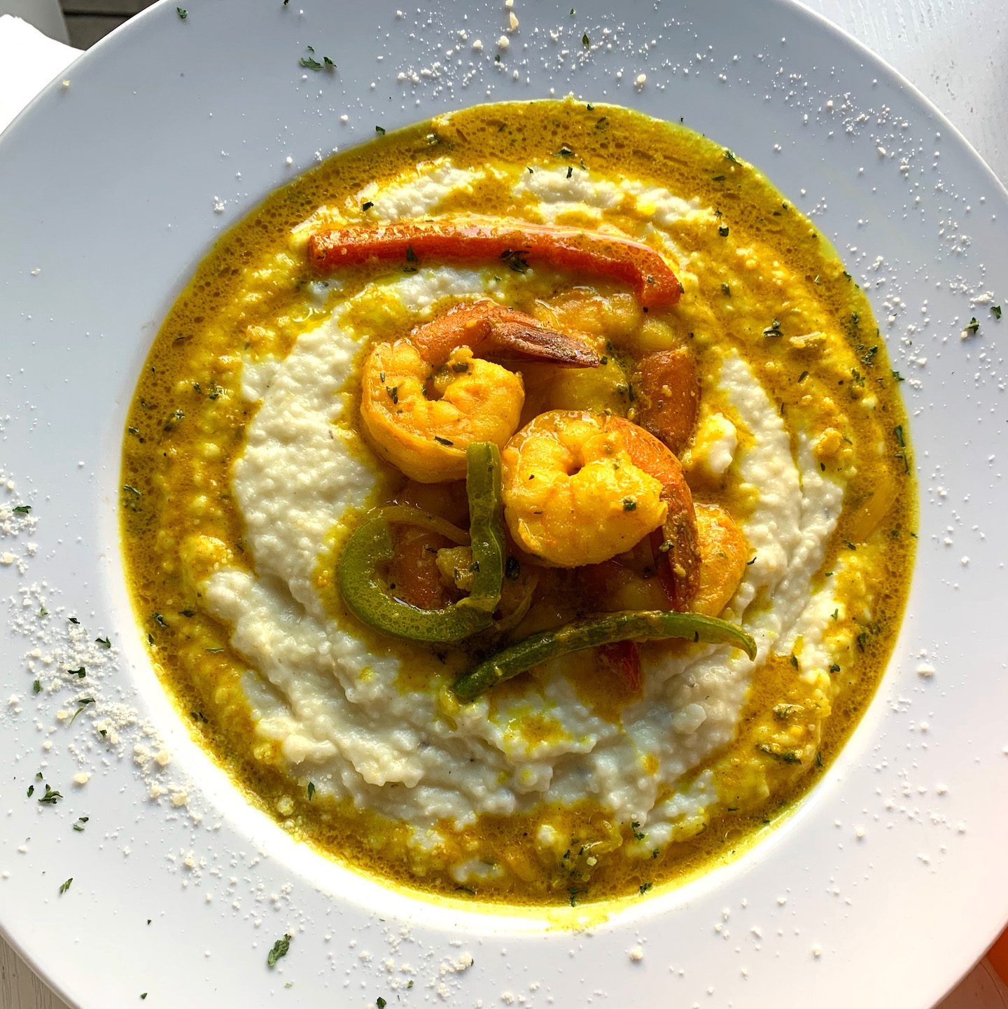 Suite 704 Brunch Curry Shrimp & Grits